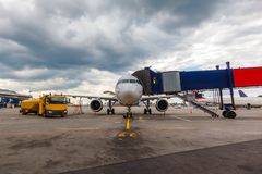 Front view of airplane at gate. And gangways for the plane Royalty Free Stock Photos
