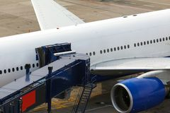 Front view of airplane at gate. And gangways for the plane Stock Photography