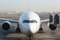 Front view of airplane at gate Stock Photo