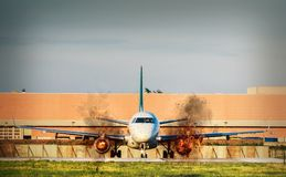 Front view of airplane with twin engines on fire on tarmac stock image