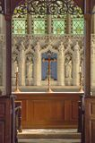 Front view of the altar at Crowcombe church in Somerset. Side lit front view of the altar in the Church of the Holy Ghost in Crowcombe in Somerset, showing stock photography