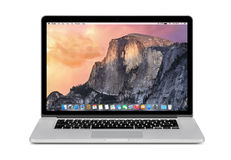 Front view of Apple 15 inch MacBook Pro Retina with OS X Yosemit Stock Photography