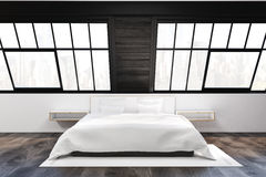 Front view of attic bedroom with two windows Royalty Free Stock Photography