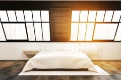 Front view: attic bedroom with two windows, toned Stock Photos