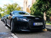 Front view of Audi TT sport race car in city. Strasbourg, France - Oct 1, 2017: Front view of luxury new black sport Audi TT sport race car parked on a street in royalty free stock photos