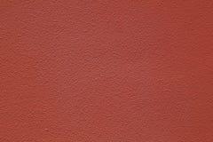 Front View av den grova betongväggen i röd brun färg, för bakgrund Fotografering för Bildbyråer
