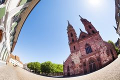 Front view of Basel Munster against blue sky. Fish-eye picture of red sandstone cathedral Basel Munster against blue sky, Switzerland Stock Photos