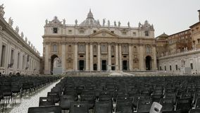 Front view of the Basilica of Saint Peter in Vatican City Italy with lots of chairs outside for people to listen to the. Mass, Dolly shot stock footage
