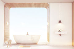 Front view of bathroom with wood, white, toned Royalty Free Stock Photo