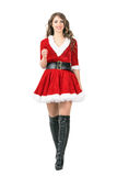 Front view of beautiful young female Santa Claus walking towards camera Stock Image