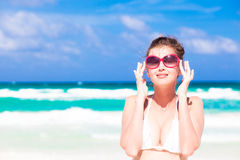 Front view of beautiful young woman in sunglasses Stock Photo