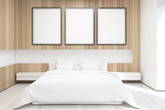 Front view of bedroom with tree posters Royalty Free Stock Photography