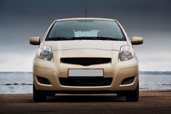 Front view of a beige car stock photo