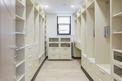 Dressing room with wardrobe with many shelf. stock photography