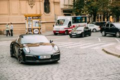 Front View Of Black Porsche 991 Targa 4S Car Moving On Street. Stock Photo
