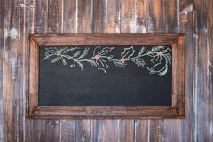 Front view of a blank blackboard over  weathered wooden surface. Front view of a blank blackboard over a weathered wooden surface, blackboard Royalty Free Stock Photos