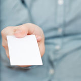 Front view of blank business card in hand Royalty Free Stock Photos