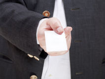 Front view of blank business card in male hand Stock Photo