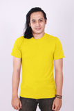 Front View Blank Yellow Shirt on Asian Male Model royalty free stock image