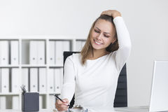Front view of blond girl writing in clipboard Stock Photography