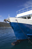 Front view of blue fishing boat Stock Images