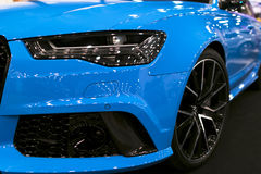 Front view of blue modern luxury sport car. Car exterior details. Headlight of a modern sport car. The front lights of the car. Stock Photography