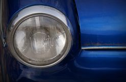 Front view of blue retro car. Front view of vintage classic car. Blue background. Oldtimer MB Stock Image