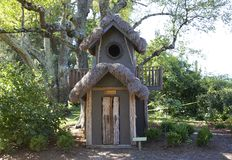 Front view of Blue Tree House with a Grass Roof Royalty Free Stock Images