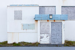 Front view of a boarded-up abandoned building in Iceland Stock Images
