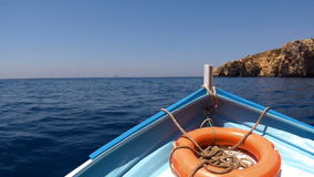 Front view boat with lifebuoy,floating on blue sea. stock video footage