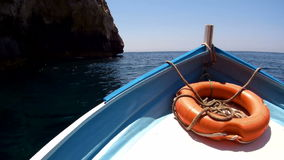 Front view boat with lifebuoy,floating on blue sea. stock footage