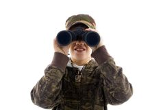 Front view boy looking through binoculars Stock Image