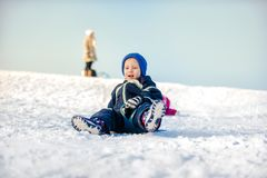 Front view of boy on sled Stock Image