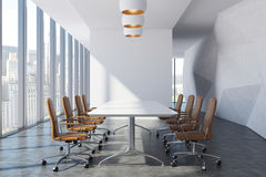 Front view of a brown chair conference room. Front view of a modern meeting room with brown chairs standing along a table. White wall. 3d rendering mock up Royalty Free Stock Images