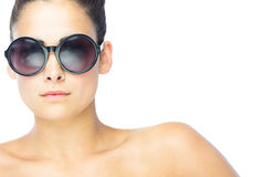 Front view of brunette woman wearing gigantic round sunglasses Royalty Free Stock Image