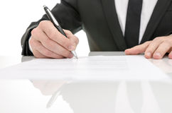 Front view of a business man signing a contract Stock Image