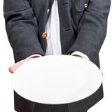Front view of businessman holds empty white plate Royalty Free Stock Photography