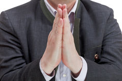 Front view of businessman praying hands Stock Photo