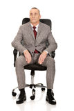 Front view of businessman sitting on armchair Royalty Free Stock Photos