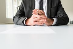 Front view of businessman sitting at his office desk stock photos