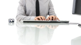 Front view of businessman working on computer Royalty Free Stock Photos