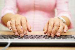 Front view of businesswoman typing on laptop computer Stock Image