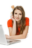 Woman lying on the floor with her laptop Royalty Free Stock Photography
