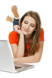 Woman lying on the floor with her laptop Royalty Free Stock Photo