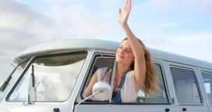 Woman waving out of camper van window 4k
