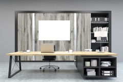 Front view of a CEO office with poster, wooden doors and a bookc Royalty Free Stock Images