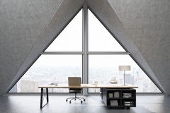 Front view of a CEO office with triangular window Royalty Free Stock Photography