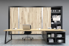 Front view of a CEO office with wooden doors and a bookcase Royalty Free Stock Image