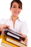 Front view of cheerful woman holding text books Royalty Free Stock Photos