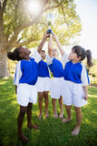 Front view of children soccer team celebrating a victory Royalty Free Stock Photography